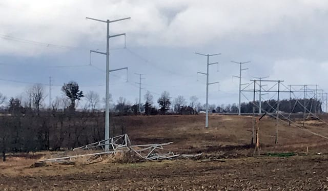 a toppled transmission line along the right-of-way